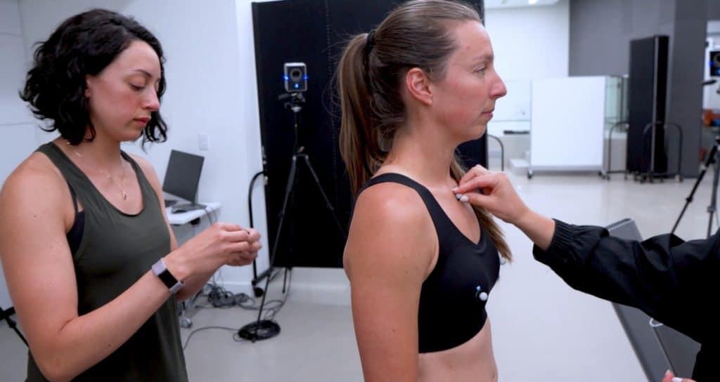 Technician places sensors on women to test lululemon's My Signature Movement technology.